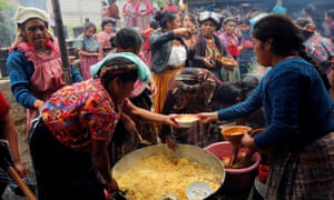 Villagers prepare food at the wake in Gómez's home village of San Juan Ostuncalco in western Guatemala.