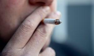 A man smoking a cigarette.