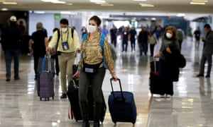 FILE PHOTO: People wear protective face masks at Benito Juarez International Airport in Mexico City, Mexico.
