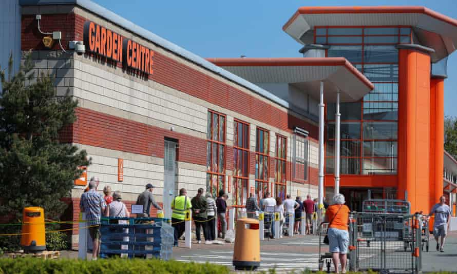 People queue outside a B&Q in Warrington, Cheshire.