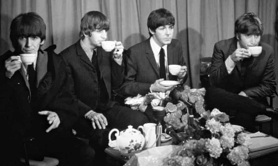 The Beatles sipping tea in 1965.