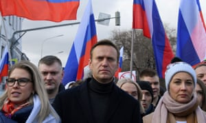 Alexei Navalny, his wife Yulia, opposition politician Lyubov Sobol and other demonstrators taking part in a march in memory of murdered Kremlin critic Boris Nemtsov in Moscow in February.