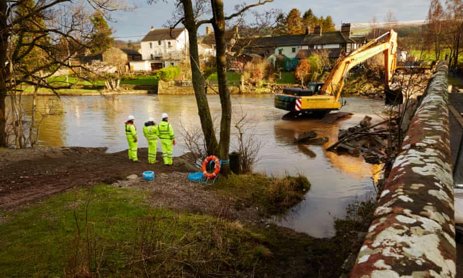 Contractors removing Pooley Bridge in Ullswater, Cumbria, which collapsed in heavy storms last December