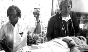 Austrian Formula One racer Niki Lauda being admitted to the burns unit of a hospital after he crashed his Ferrari on the Nürburgring on August 1, 1976.