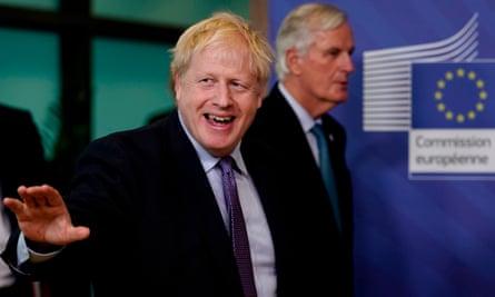 Boris Johnson with the EU's chief Brexit negotiator Michel Barnier in Brussels in October 2019.