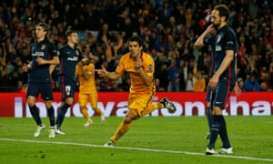 Luis Suarez celebrates scoring the second goal for Barcelona.
