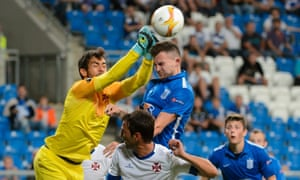 Lech Poznan, who usually play in front of 20,000, take on Belenenses in front of a mass of empty seats at the Inea Stadium.