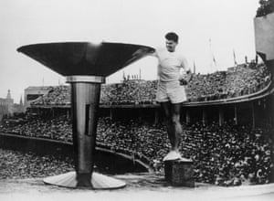 Ron Clarke lights the Olympic flame