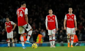 Arsenal's Mesut Ozil and Granit Xhaka dejected after Brighton's second goal.