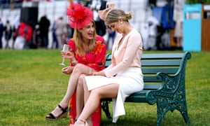 Racegoers enjoy a drink during day three of Royal Ascot.