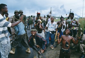 Young rebels posing and ECOMOG soldiers in Monrovia during the Liberian civil war.