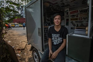 Pius operates one of the city's only skateboard shops out of the back of a small van. Most of his products are imported from Thailand. For those who cannot afford to buy their own boards in this impoverished country, Pius rents them out for a small fee.