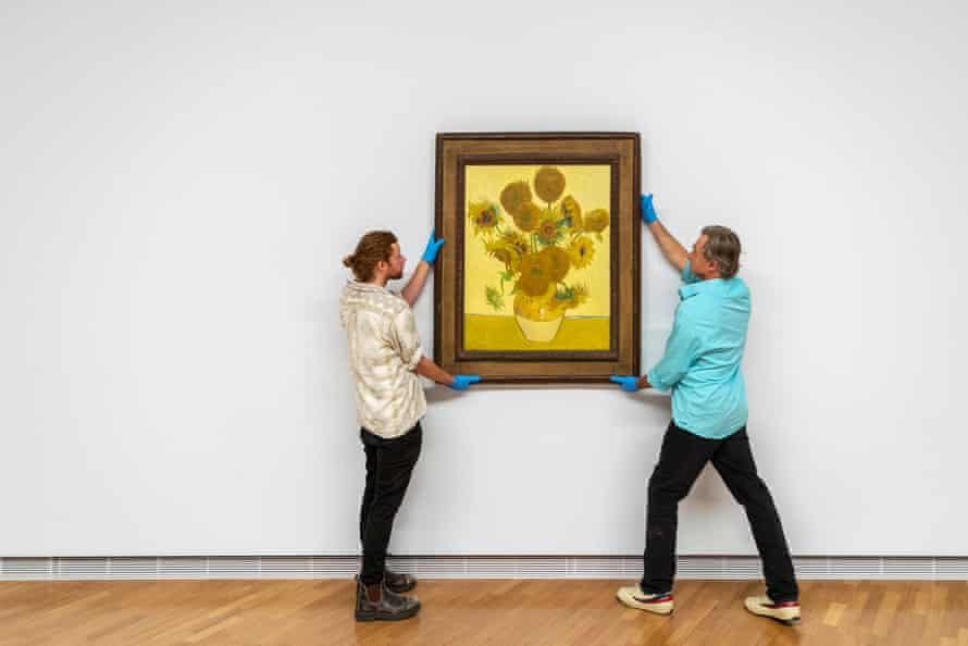 NGA staff installing Vincent van Gogh's Sunflowers on 22 February 2021 in Canberra.
