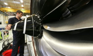 An employee checks the nose cone of an aircraft engine on the production line at the Rolls-Royce factory in Derby