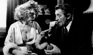 Sylvia Miles and Robert Mitchum in Farewell, My Lovely, 1975.