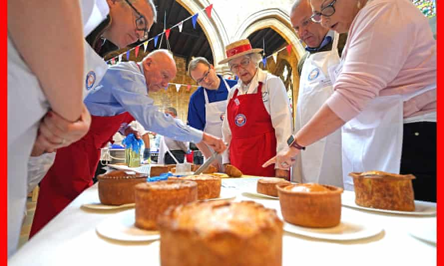 An array of pies are judged during the Annual British Pie awards at St Mary's church in Melton Mowbray, Leicestershire.