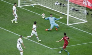 Andre Silva, right, smashes in Portugal's third.