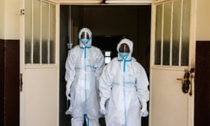 Staff in full safety gear outside a new isolation unit at the Connaught hospital in Freetown.