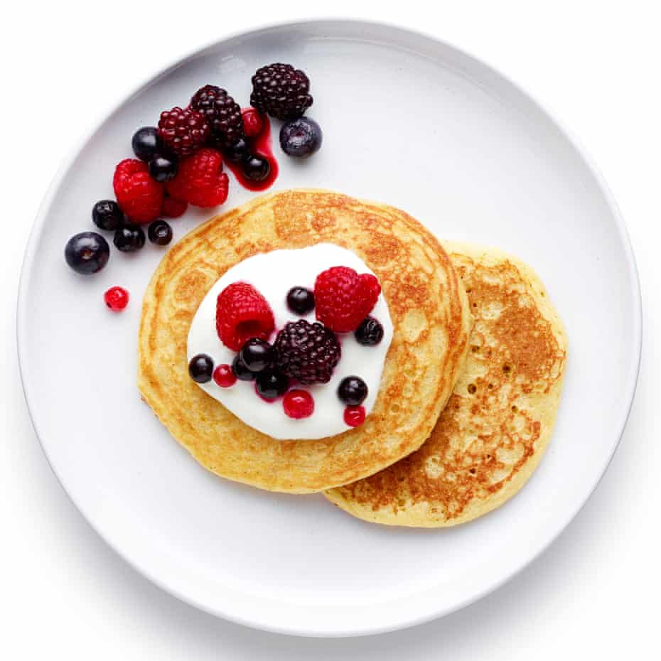Felicity Cloake's American pancakes served with fresh fruit and yoghurt.