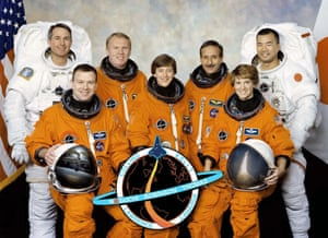 Andy Thomas (back row, second from left) with his crew mates as they prepare for a launch of the space shuttle Discovery in July 2005