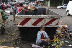 Asunción, Paraguay Fabian Ramirez, 11, scavenges with his family for discarded vegetables at the Mercado de Abasto during the fourth week of quarantine.