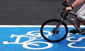 A cyclist on the blue cycle lane in Kennington, London.