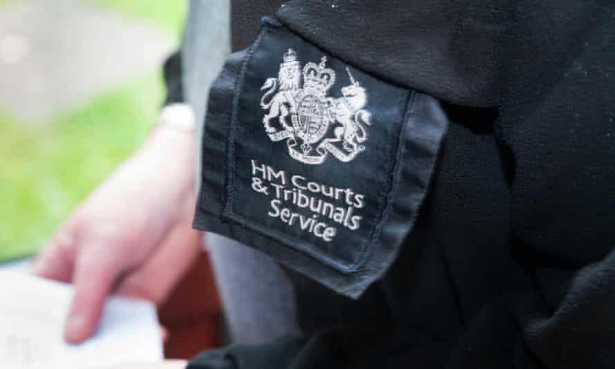 A bailiff serves an eviction warrant