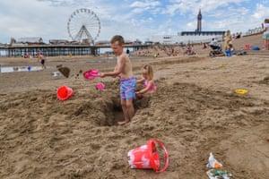 Children build sandcastles on Blackpool Beach