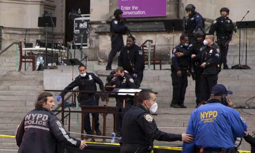 A man was shot by police after shots rang out at the end of a Christmas choral concert on the steps of the Manhattan cathedral Sunday afternoon.