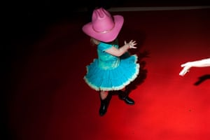 A young girl dances during one of the musical performances