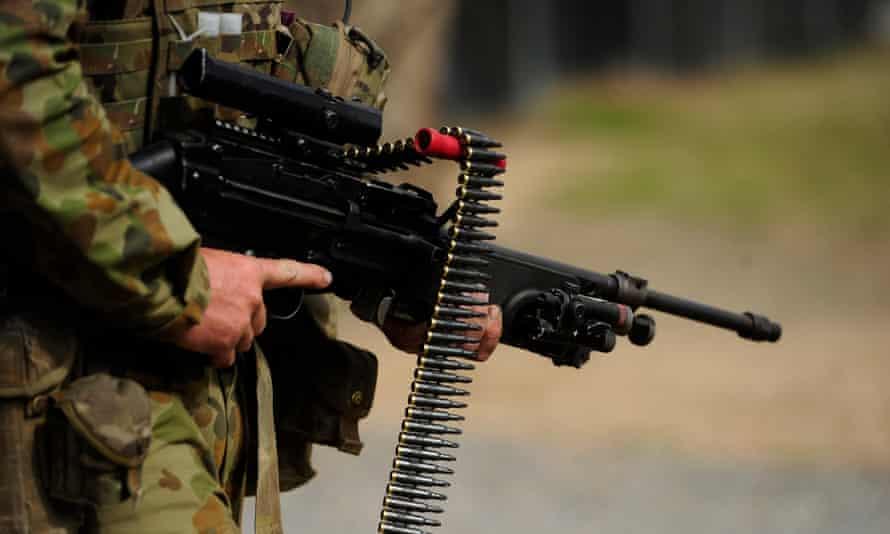 File photo of an Australian soldier carrying a machine gun