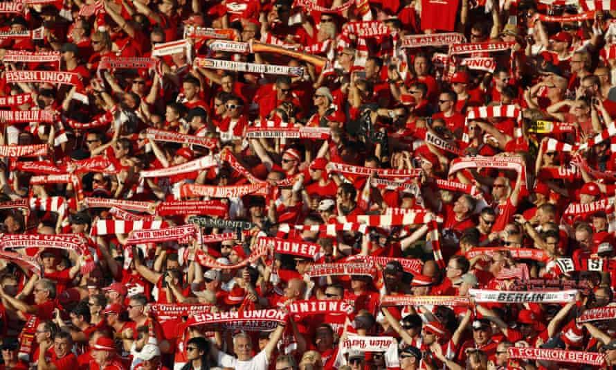 Fans of Union Berlin sing before a Bundesliga match.