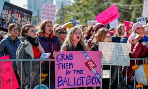 Women gather for a rally and march at Grant Park on 13 October in Chicago, Illinois to inspire voter turnout ahead of midterm elections.