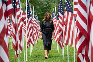 Huntington, USUS First Lady Melania Trump walks through 453 American flags, each representing a child in foster care in Cabell County, West Virginia, many due to the opioid epidemic, at Ritter Park