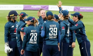 Anya Shrubsole of England celebrates taking the wicket of Sune Luus of South Africa with a catch from Katherine Brunt.