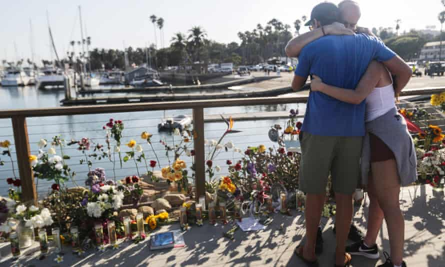 People embrace at a makeshift memorial for victims of the Conception boat fire on 3 September 2019 in Santa Barbara, California.