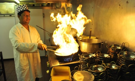 A curry chef in action in Brick Lane, east London.