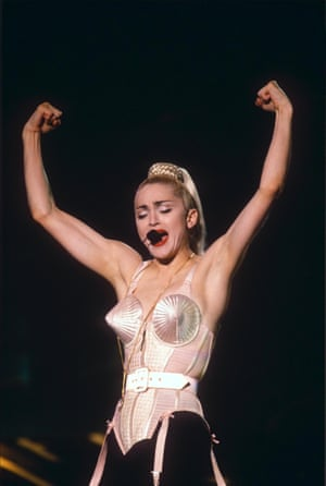 Performing in Tokyo in her iconic Jean Paul Gaultier conical corset.