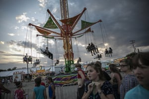 People wait to ride a revolving swing at the Perry state fair in New Lexington.
