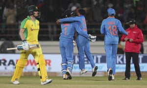 India celebrate the dismissal of Australia's Steve Smith.