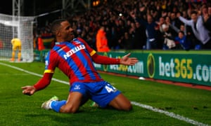Jason Puncheon slides on his knees in celebration after scoring against Manchester City in 2015.