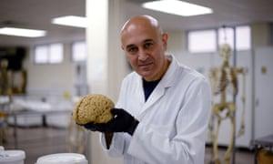 Prof Jim Al-Khalili with a model of the human brain.