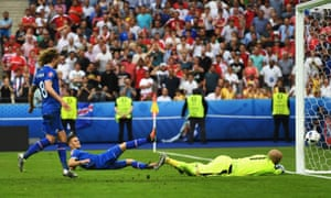 Iceland's Arnor Ingvi Traustason squeezes the ball past Austria keeper Robert Almer to score the winner.