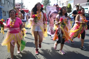 Activist Diana Ceballos, second left, takes part in a procession for felled women like her 14-year old cousin. In 2014 Ceballos's cousin was raped and stabbed to death by an ex-boyfriend of the teenager's mother. It took three years to secure a jail sentence for the perpetrator even though he had confessed via a text message to the mother immediately after the murder
