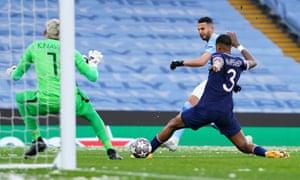 Riyad Mahrez of Manchester City scores his team's first goal.