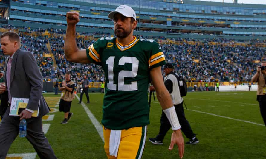 Aaron Rodgers walks off the field after his Sunday's game