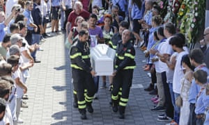 The coffin of Giulia Rinaldo is carried out of the funeral service.