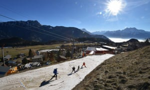 Tourists ski on a thin layer of snow in Leysin, Switzerland during the country's warmest December on record.