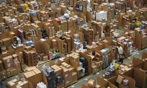Row after row of boxes piled high at an Amazon fulfilment centre