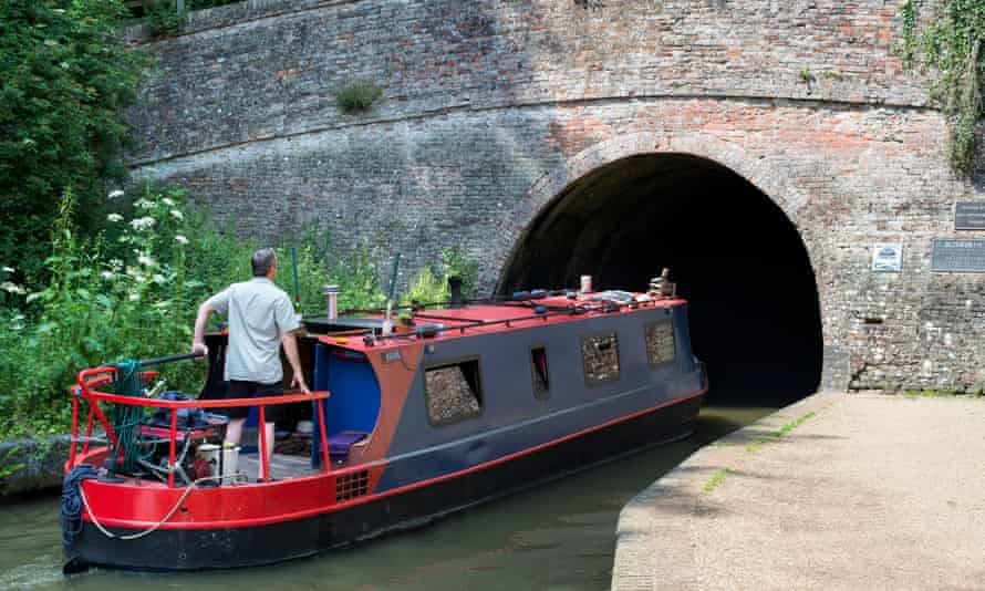 Narrowboat on the Grand Union Canal, entering the Blisworth tunnel, Northamptonshire.